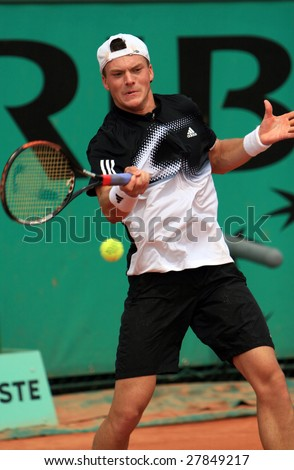 PARIS - MAY 23: Russian professional tennis player Evgeny Korolev during the match at French Open, Roland Garros on May 23, 2008 in Paris, France. - stock photo