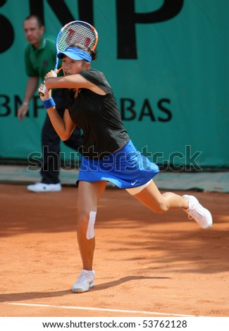 PARIS - MAY 21: Shuai ZHANG of China plays the 3rd round qualification match at French Open, Roland Garros on May 21, 2010 in Paris, France. - stock photo