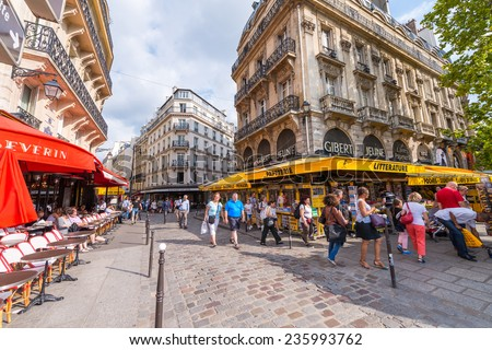 PARIS - MAY 21, 2014: Tourists walk in Quartier Latin. More than 30 million people visit Paris annually. - stock photo