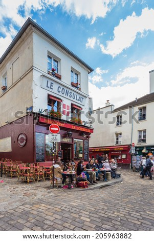 PARIS - May 14: View of typical paris cafe on May 14, 2014 in Paris. Montmartre area is among most popular destinations in Paris, Le Consulat is a typical cafe. - stock photo