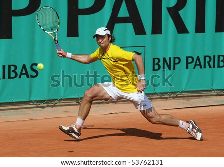 PARIS - MAY 21: Yuri SCHUKIN of Kazakhstan in action at French Open, Roland Garros qualification 3rd round match on May 21, 2010 in Paris, France. - stock photo