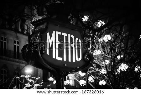 Paris Metro subway sign and Christmas illumination. Black and white. Retro style postcard. - stock photo