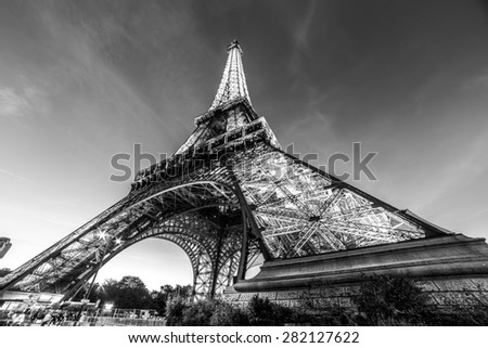 PARIS - NOV 1: A black and white photo of Eiffel Tower Light Performance Show in Dusk on November 1, 2014. The Eiffel tower is the most visited monument of France.
