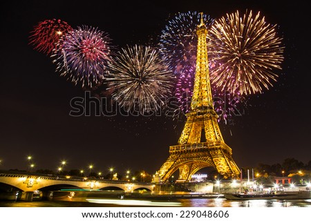 PARIS - NOV 1: Eiffel Tower Light Performance Show an Firewors in the  Dusk on November 1, 2014. The Eiffel tower is the most visited monument of France. - stock photo