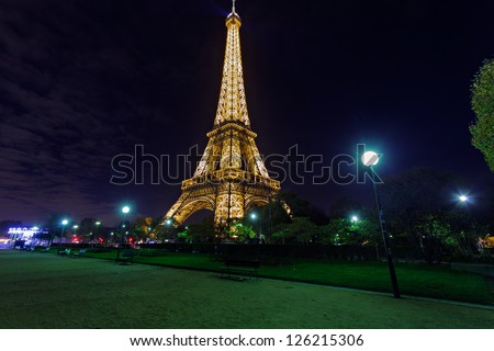 PARIS - NOV 08 : Illuminated Eiffel tower at midnight on November 8, 2012 in Paris. The Eiffel tower is the most visited monument of France. - stock photo