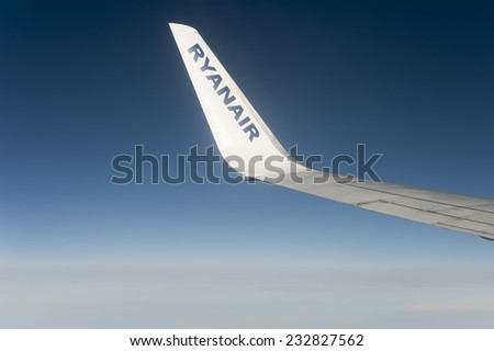 PARIS-NOV 23:Looking through window aircraft Ryanair during flight in wing on November 23, 2014. Ryanair is one of the largest low-cost European airline by scheduled passengers carried.