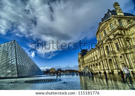 PARIS - NOV 16: Louvre Pyramid reflects on Water on November, 16, 2011 in Paris. The Louvre contains more than 380.000 objects and displays 35.000 artworks in eight departments