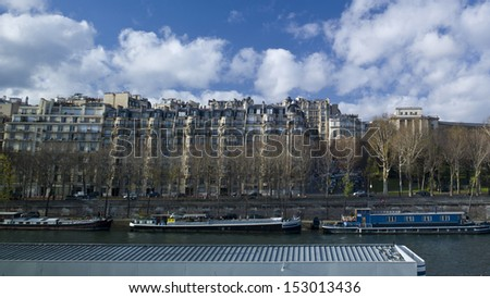 PARIS - NOV 25: Sightseeing boats dock along river Seine on November 25, 2012 in Paris, France. Paris is the most visited city in the world with 15.6 million international arrivals in 2011. - stock photo