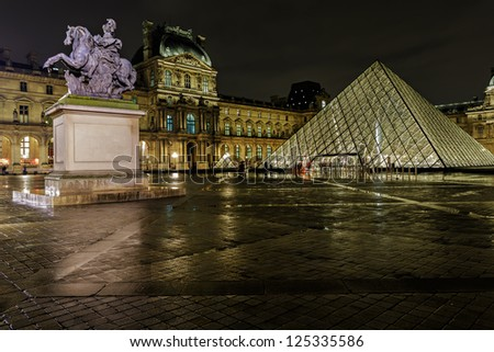 PARIS - NOV 09 : View of the Louvre Pyramid and Pavillon Richelieu in the evening, Nov 09, 2012, Paris, France. The pyramid serves as the main entrance to the Louvre Museum