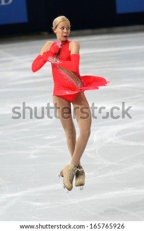 PARIS - NOVEMBER 15, 2013: Anna POGORILAYA of Russia performs during ladies' short skating event at Eric Bompard Trophy 2013 in Palais-Omnisports de Bercy, Paris, France. - stock photo