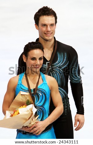 PARIS - NOVEMBER 15: Canadian ice skaters Meagan Duhamel / Craig Buntin pose during medal ceremony at ISU Grand Prix - Eric Bompard Trophy in Bercy, Paris, France on November 15, 2008. - stock photo