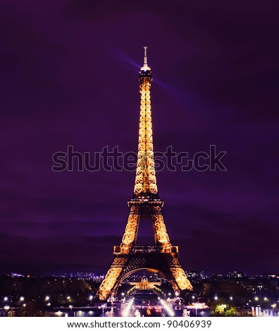 PARIS - NOVEMBER 12: Eiffel Tower at night on November 12, 2010 in Paris, France. The Eiffel tower is the most visited monument of France with over 6 million visitors every year. - stock photo