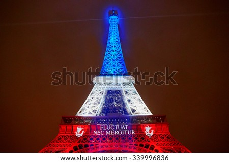PARIS - NOVEMBER 16: Eiffel tower illuminated with colors of the French national flag on the day of mourning on November 16, 2015 in Paris