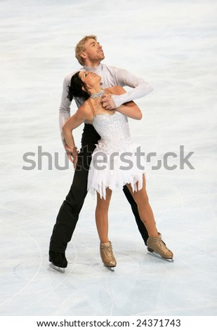 PARIS - NOVEMBER 15: French ice skaters Isabelle Delobel / Olivier Schoenfelder perform during the ice dance event of ISU Grand Prix - Eric Bompard Trophy in Bercy, Paris, France on November 15, 2008. - stock photo
