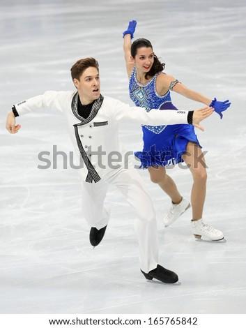 PARIS - NOVEMBER 15, 2013: Ksenia MONKO / Kirill KHALIAVIN of Russia perform short dance at Eric Bompard Trophy 2013 in Palais-Omnisports de Bercy, Paris, France. - stock photo