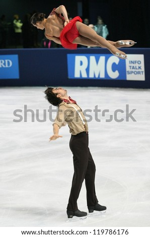 PARIS - NOVEMBER 16: Meagan DUHAMEL / Eric RADFORD of Canada perform during pairs short skating event at Eric Bompard Trophy on November 16, 2012 at Palais-Omnisports de Bercy, Paris, France. - stock photo
