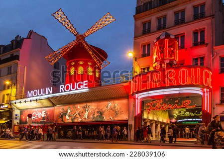PARIS - OCT 29: The Moulin Rouge by night, on October 29, 2014 in Paris, France. Moulin Rouge is a famous cabaret built in 1889, locating in the Paris red-light district of Pigalle  - stock photo