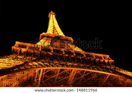PARIS - October 14,2012: Eiffel Tower brightly illuminated at night on October 14, 2012 in Paris. The Eiffel tower is the most visited monument of France.