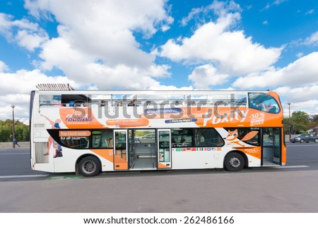 PARIS - OCTOBER 13, 2015: French tourist bus with unknown tourists on the Bir-Hakeim bridge in front of the famous eiffel tower - stock photo