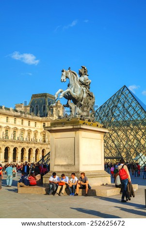 PARIS - OCTOBER 9: Louis XIV statue at the Louvre museum on October 9, 2014 in Paris, France. It's one of the world's largest museums and a historic monument and a central landmark of Paris. - stock photo