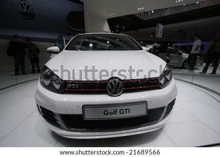 PARIS - OCTOBER 13 : People look at the new Volkswagen Golf 6 at the 2008 Paris Motor Show October 13, 2008 in Paris. The show attracts more of one million people every 2 years