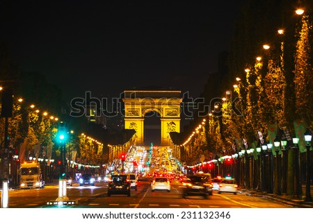PARIS - OCTOBER 13: The Arc de Triomphe de l'Etoile on October 13, 2014 in Paris, France. It's one of the most famous monuments in Paris and stands in the centre of the Place Charles de Gaulle - stock photo