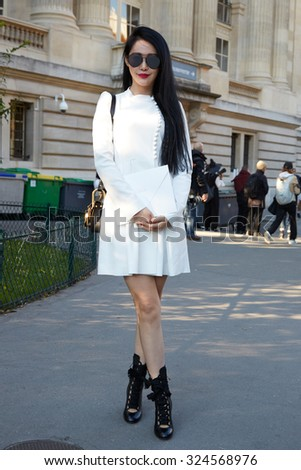 PARIS - OCTOBER 1: Woman poses for photographers before Chloe show with Chloe shoes, Paris Fashion Week Day 3, Spring / Summer 2016 street style on October 1, 2015 in Paris. - stock photo