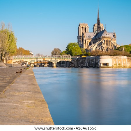 Paris, panorama over river Seine with Notre-Dame Cathedral from the back on a bright day in Spring. This image is toned. - stock photo