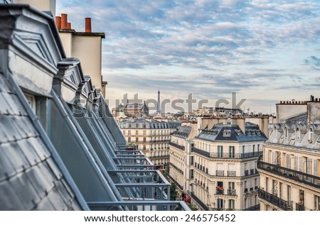 Paris roofs with Eiffel Tower in background, France - stock photo