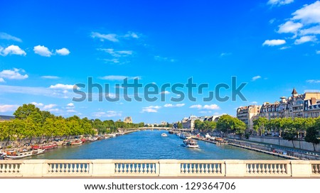 Paris, Seine river and traditional boats. Aerial view from a bridge balcony. France, Europe - stock photo
