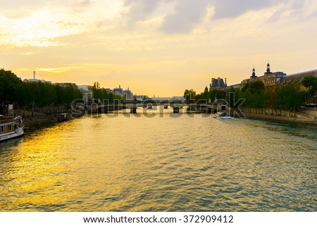 PARIS - SEP 06: Seine river in the evening on September 06, 2014 in Paris, France. Paris, aka City of Love, is a popular travel destination and a major city in Europe