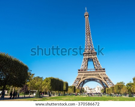 PARIS - SEPTEMBER 28: Eiffel tower is landmark of Paris, France under sunny blue sky, was taken on September 28, 2015.