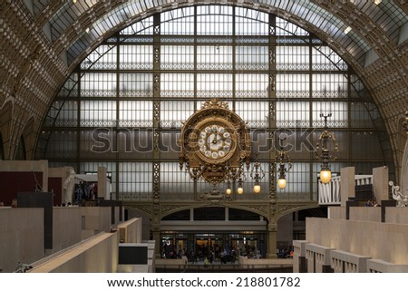 PARIS -SEPTEMBER 7, 2014: Golden clock of the museum D'Orsay in Paris, France. Musee d'Orsay has the largest collection of impressionist and post-impressionist paintings in the world.  - stock photo