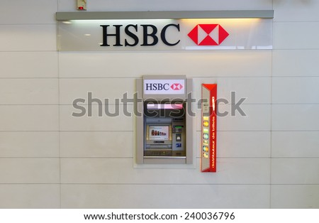 PARIS - SEPTEMBER 10: HSBC ATM on September 10, 2014 in Paris, France. HSBC Holdings plc is a British multinational banking and financial services company headquartered in London, United Kingdom - stock photo