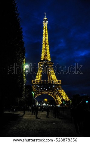 PARIS - SEPTEMBER 25, 2015: Illuminated Eiffel Tower at dusk. The tower is the most visited landmark of France.
