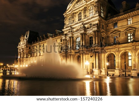 PARIS - SEPTEMBER 25: Louvre museum at night on September 25,2013. Louvre museum is one of the world's largest museums with more than 8 million visitors each year. - stock photo