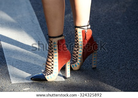 PARIS - SEPTEMBER 30: Paula Cademartori shoes before Rochas show, Paris Fashion Week Day 2, Spring / Summer 2016 street style on September 30, 2015 in Paris. - stock photo