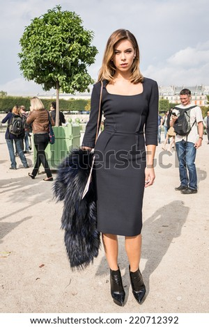 PARIS - SEPTEMBER 30, 2014: Stylish european woman with black skirt in the Tuileries Garden. Paris Fashion Week: Ready to Wear 2014/2015 is held from September 23 to October 1, 2014. - stock photo