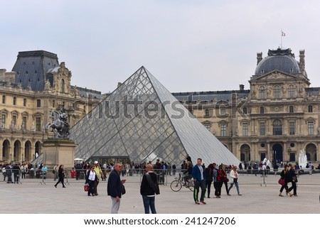 PARIS - SEPTEMBER 24: The Louvre Palace and the Pyramid, one of the world's largest museums and central landmark, taken on September 24, 2014 in Paris, France - stock photo