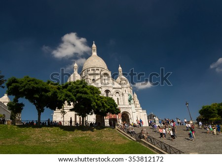 PARIS - SEPTEMBER 16, 2014: Tourists near the Basilica of the Sacred Heart of Paris (Sacre-Coeur) is a Roman Catholic church. Located at the summit of the butte Montmartre. Paris, France. - stock photo