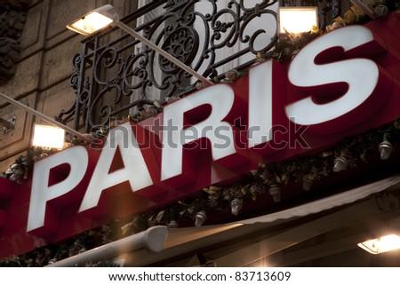 Paris Sign illuminated at night - stock photo