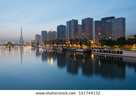 Paris skyline with the Eiffel tower in the background - stock photo