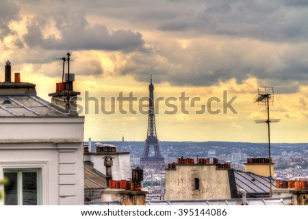 Paris spring cityscape with the Eiffel tower seen from Montmartre in the afternoon - stock photo
