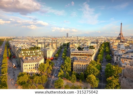 Paris sunset city view with Eiffel Tower and Champs Elysees avenue. - stock photo