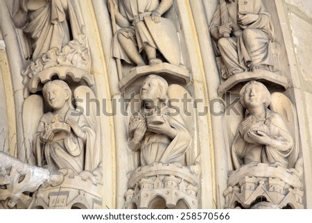 Paris -  the Sainte-Chapelle (Holy Chapel). Archivolts of The portal on both sides  is decorated with low relief