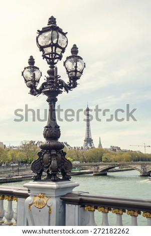 Paris view. Bridge of Alexandre III against the Eiffel Tower in Paris, France.