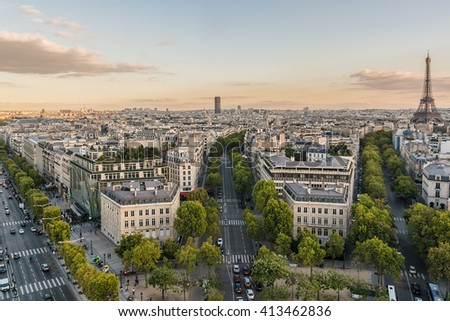 Paris view from the top of Arc de Triomphe de l'Etoile on Sunset. Eiffel Tower on the background. France. - stock photo