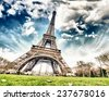Paris. Wonderful wide angle view of Eiffel Tower from street level in December. - stock photo