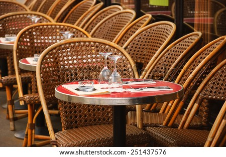 Parisian cafe terrace. Selective focus on the glasses.  - stock photo