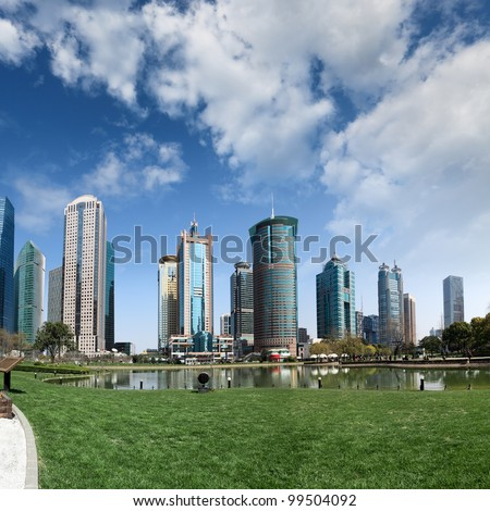park and skyscrapers under the blue sky in shanghai - stock photo